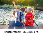 Little Boy And Girl Fishing In...