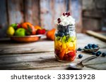 colorful fruit salad in a jar... | Shutterstock . vector #333913928