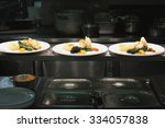 plated food in kitchen | Shutterstock . vector #334057838