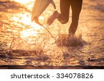 surfer running in the water... | Shutterstock . vector #334078826