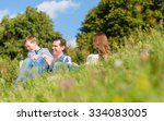 family cuddling sitting on...   Shutterstock . vector #334083005