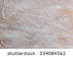 Small photo of Rough wooden rectangular used cutting board background with flour directly from above closeup