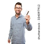 Small photo of man holding a credit card