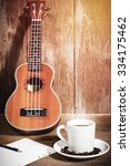 Small photo of coffee cup and coffee beans and Ukulele with papernote