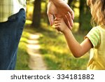 the parent holds the hand of a... | Shutterstock . vector #334181882