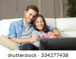 happy couple watching a movie... | Shutterstock . vector #334277438
