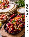 pork fajitas with onions and... | Shutterstock . vector #334323842
