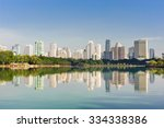 buildings and trees reflex in a ... | Shutterstock . vector #334338386
