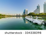 swan paddle boat in a lake of... | Shutterstock . vector #334338398