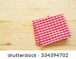 red towel over wooden kitchen...   Shutterstock . vector #334394702
