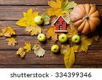 Toy House And Pumpkin With...