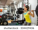 determined woman lifting a... | Shutterstock . vector #334429436