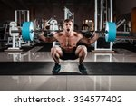 man at the gym. execute... | Shutterstock . vector #334577402