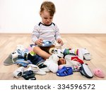 toddler playing with a lot of... | Shutterstock . vector #334596572