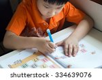 little boy writing math... | Shutterstock . vector #334639076