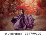 lady in a luxury lush purple... | Shutterstock . vector #334799102