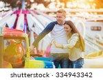 beautiful young family enjoying ...   Shutterstock . vector #334943342