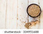 raw pearl barley in a ceramic... | Shutterstock . vector #334951688