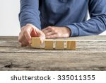 front view of male hand placing ... | Shutterstock . vector #335011355