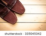 canvas shoes on wooden floor... | Shutterstock . vector #335045342