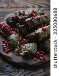 dolmades with pomegranate seeds.... | Shutterstock . vector #335080688