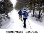 Couple snowshoeing in Colorado - stock photo
