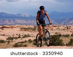 Female mountain biker on the Slickrock trail, Maob, Utah - stock photo