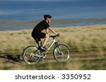 Action shot of mountain biker in motion - stock photo