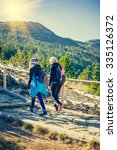 mother with daughter hikers... | Shutterstock . vector #335126372