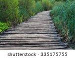 wooden bridge footpath over a...   Shutterstock . vector #335175755
