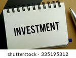Investment memo written on a notebook with pen - stock photo