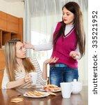 two women having quarrel over... | Shutterstock . vector #335221952