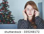 young unhappy girl has headache ... | Shutterstock . vector #335248172