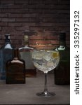 gin and tonic on a wooden table ... | Shutterstock . vector #335297132