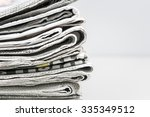 newspapers folded and stacked | Shutterstock . vector #335349512