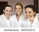three young happy women at spa...   Shutterstock . vector #335352572