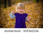Smiling Baby In Autumn Forest...