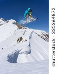 flying snowboarder on mountains ... | Shutterstock . vector #335364872