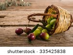 fresh olives in a basket ... | Shutterstock . vector #335425838
