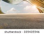 asphalt road in front of the... | Shutterstock . vector #335435546