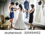 female trying on wedding dress... | Shutterstock . vector #335454452