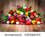tulips on wooden background | Shutterstock . vector #335468252
