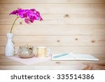 teapot and open book with... | Shutterstock . vector #335514386