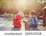 Two Kids Boy And Girl Fishing...