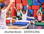 group of children doing kids... | Shutterstock . vector #335541356