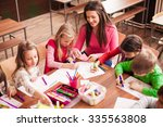pupil boys and girls sitting... | Shutterstock . vector #335563808