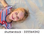 pretty little girl lies on... | Shutterstock . vector #335564342
