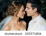 beautiful couple posing in the... | Shutterstock . vector #335571806