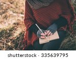 Stock photo woman writing in the notebook 335639795