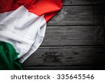 flag of italy on dark wood... | Shutterstock . vector #335645546